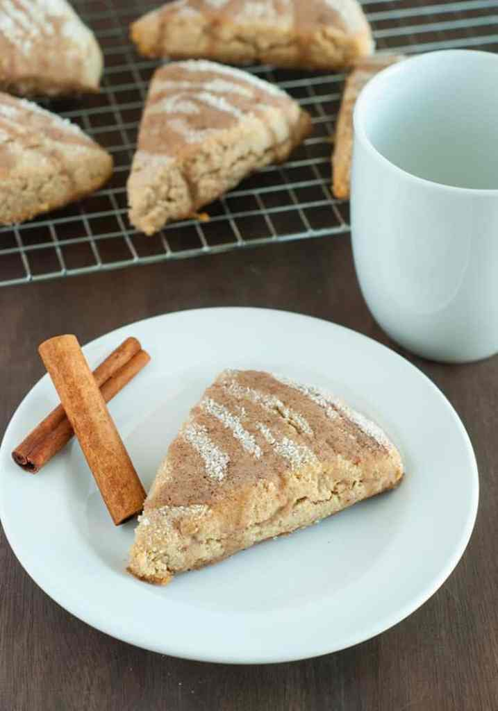 Cinnamon Scones - tender and flaky cinnamon scones powdered in sweet cinnamon and drizzled with a vanilla glaze.