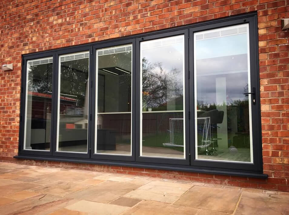 Anthracite Grey Bi Folding Doors with White integral blinds