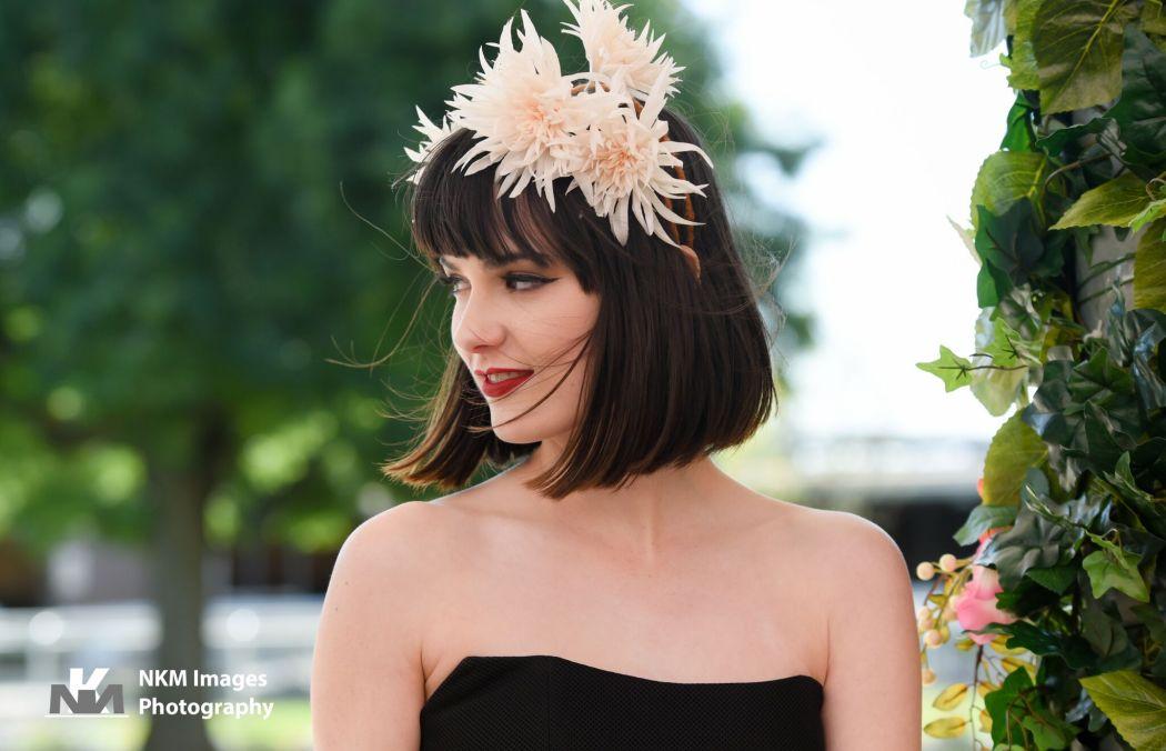 Mel wears Elle Zeitoune 'Jaylyn' dress from Something Borrowed, Sylvy Earl 'Flower Silhouette' headpiece and ________ shoes. Kristen wears Nicholas 'Mesh Ball Dress' from Something Borrowed and 'Flowers' headpiece from Sylvy Earl.