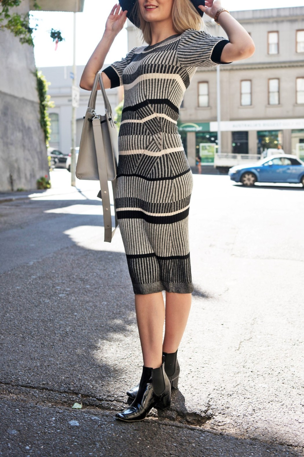 Kristen wears Lucid Label's Linear Bodycon Knit dress in Black and White.