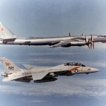 A U.S. Navy Grumman F-14A Tomcat of Fighter Squadron VF-114 Aardvarks flying alongside a Soviet Tupolev Tu-95RT Bear D maritime patrol aircraft. (US Navy photo)