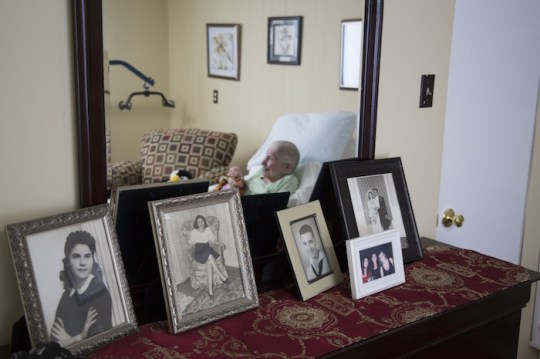 Finster began hospice care at the beginning of the summer. Pictures of her and her husband as a young woman are the last reminders in her room of her life before dementia.
