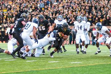 Freshman running back Marcus Cox rushes to the end zone during the Black Saturday game against Georgia Southern. The Mountaineers flew past the Eagles for a 38-14 victory at home. Photo by Aneisy Cardo | The Appalachian