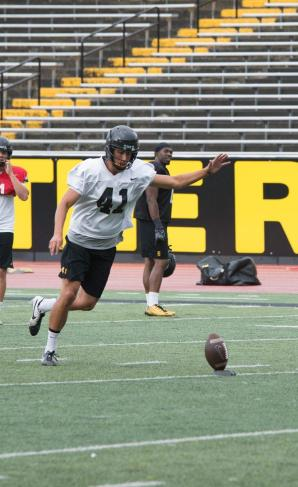 Freshman place kicker Michael Rubino works on his kick during practice on Wednesday, August 17th. Photo by Halle Keighton