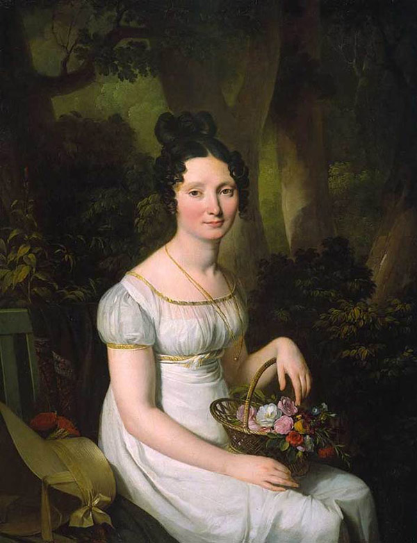 Portrait of a seated woman holding a flower basket