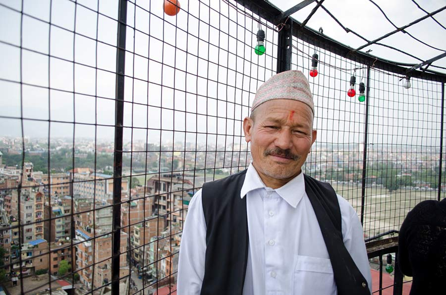 A Nepalese man at the top of Dharahara Tower in Kathmandu
