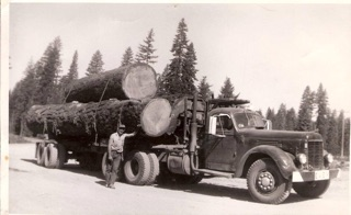 "Jack with the ""Evey"" with a three-log load of sugar pine at Greenville, CA. c. 1950."