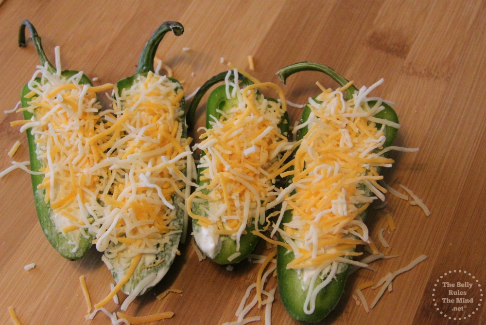 Top jalapenos with cheese