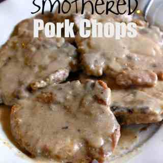 These Smothered Pork Chops use ingredients you probably already have in your kitchen and they make an amazing dinner!   Featured on The Best Blog Recipes