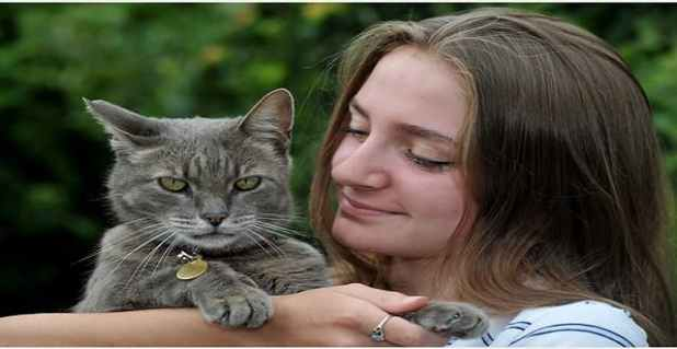 Owner Saskia Baillie with cat Sid