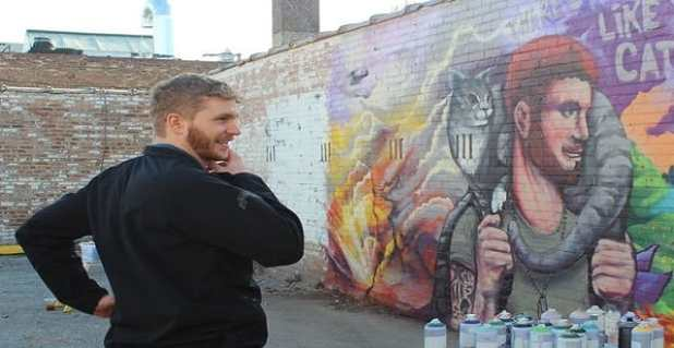 Local street artist CZR PRZ painted this mural of military veteran Wes King and his cat Steve, who helped Wes deal with Post Traumatic Stress Disorder.