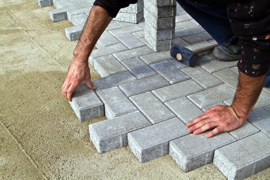 builder worker tiler tile stores built walkway or path