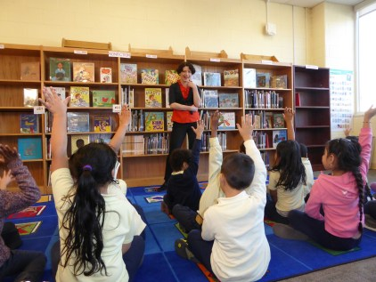 Erica S. Perl speaks to children during an author visit