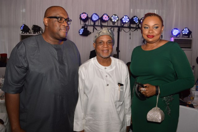 Biodun Shobanjo (middle) with Mr. John & Mrs. Mary Iwelumo