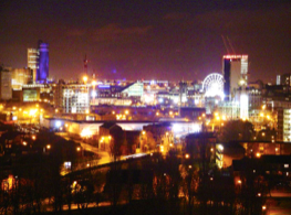 Figure 3. Skyglow in Manchester. This light is scattering off the atmosphere and falling back to the ground. As a result, the sky looks bright orange. Image taken from https://commons.wikimedia.org/