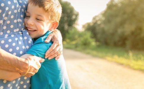 a grandson hugs his grandmother