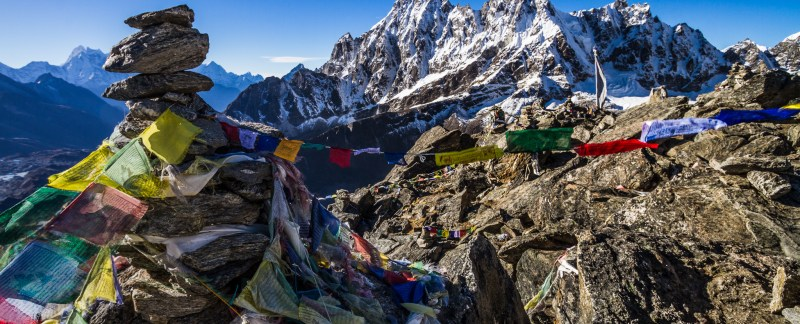 Prayer Flags And The Machermo Range From Gokyo Ri, Nepal