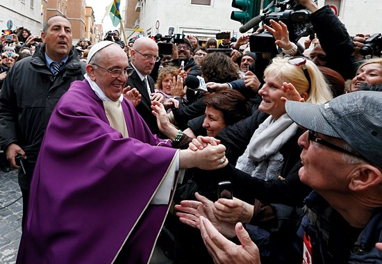Pope Francis greets people after celebrating Mass at St. Anne's Parish within the Vatican March 17. The new pope greeted every person leaving the small church and then walked over to meet people waiting around St. Anne's Gate. (CNS photo/Paul Haring)