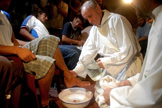 Cardinal Jorge Mario Bergoglio, now Pope Francis, washes the feet of residents of a shelter for drug users during Holy Thursday Mass in 2008 at a church in a poor neighborhood of Buenos Aires, Argentina. CNS photo / Enrique Garcia Medina, Reuters