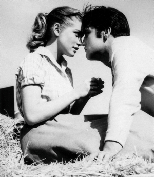 "Dolores Hart and Elvis Presley star in the 1957 movie ""Loving You."" The young starlet left a promising acting career at age 25 to join the Benedictine Abbey of Regina Laudis in Bethlehem, Conn., where today she serves as prioress. Her autobiography, ""The Ear of the Heart: An Actress' Journey From Hollywood to Holy Vows,"" co-written with Richard DeNeut, was released in May. CNS photo/courtesy of Ignatius Press"