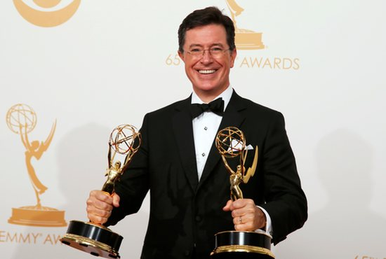 "Stephen Colbert of Comedy Central's ""The Colbert Report"" poses with his Emmys during the Academy of Television Arts & Sciences awards show in Los Angeles in September. CNS photo/Lucy Nicholson, Reuters"