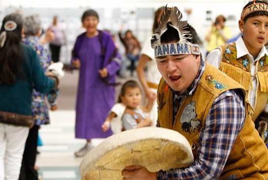 Raymond Hyslop of the Tanana Traditional Dance Group performs at a reception marking the 50th anniversary of the Diocese of Fairbanks, Alaska, Aug. 12 in Fairbanks. CNS photo