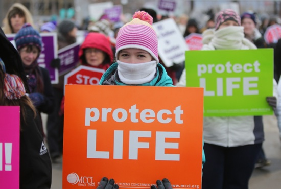 Olivia Rome of St. Hubert in Chanhassen walks on the State Capitol mall Jan. 22 during the pro-life rally following a prayer service at the Cathedral of St. Paul.