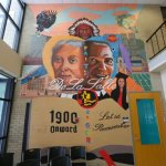 DeLaSalle alumnus guides students in painting mural of school, city history