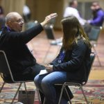 Confession is 'highlight' of NCYC as hundreds of priests share God's mercy