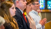 Matthew Lyons (right) with his parents, Thomas and Nancy, and sister, Monica (left) at the start of his Transitional Diaconate Ordination Mass at St. Joseph's in Endicott May 28. (Sun photo | Chuck Haupt)