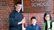 Matthew Lyons takes a moment with Owen Cruceta and Penelope Sugihara outside Holy Cross School in DeWitt. - photo COURTESY SISTER ROSE BILL, MFIC