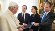Pope Francis accepts a book from Mark Zuckerberg, CEO of Facebook, who was accompanied by his wife, Priscilla Chan, during a private audience at the Vatican Aug. 29. The book details the history of internet connectivity throughout the world. At right is Greg Burke, director of the Vatican press office. (CNS photo/L'Osservatore Romano, handout) See POPE-FACEBOOK-ZUCKERBERG Aug. 29, 2016.