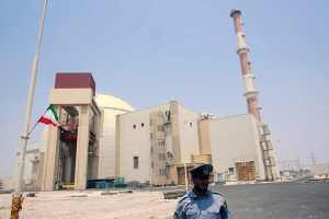 A security official stands in front of the Bushehr nuclear reactor 746 miles south of Tehran