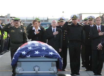 US Special agent James Watson's body is returned to the United States.