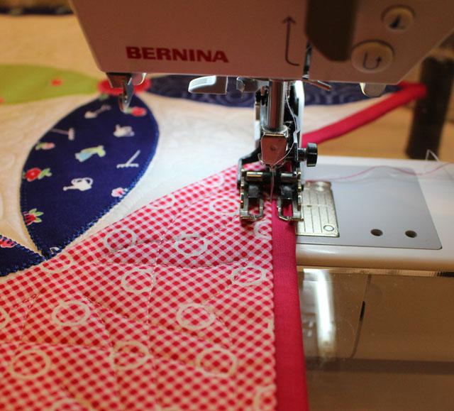 pink binding stitch in ditch