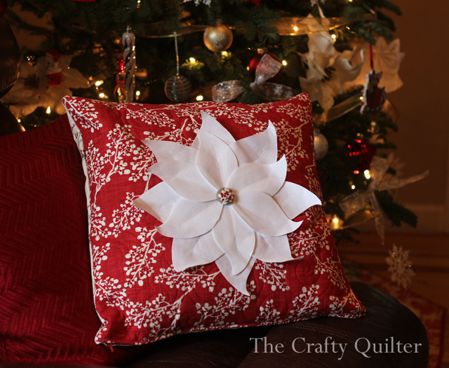 Poinsettia Pillow made by Julie Cefalu @ The Crafty Quilter