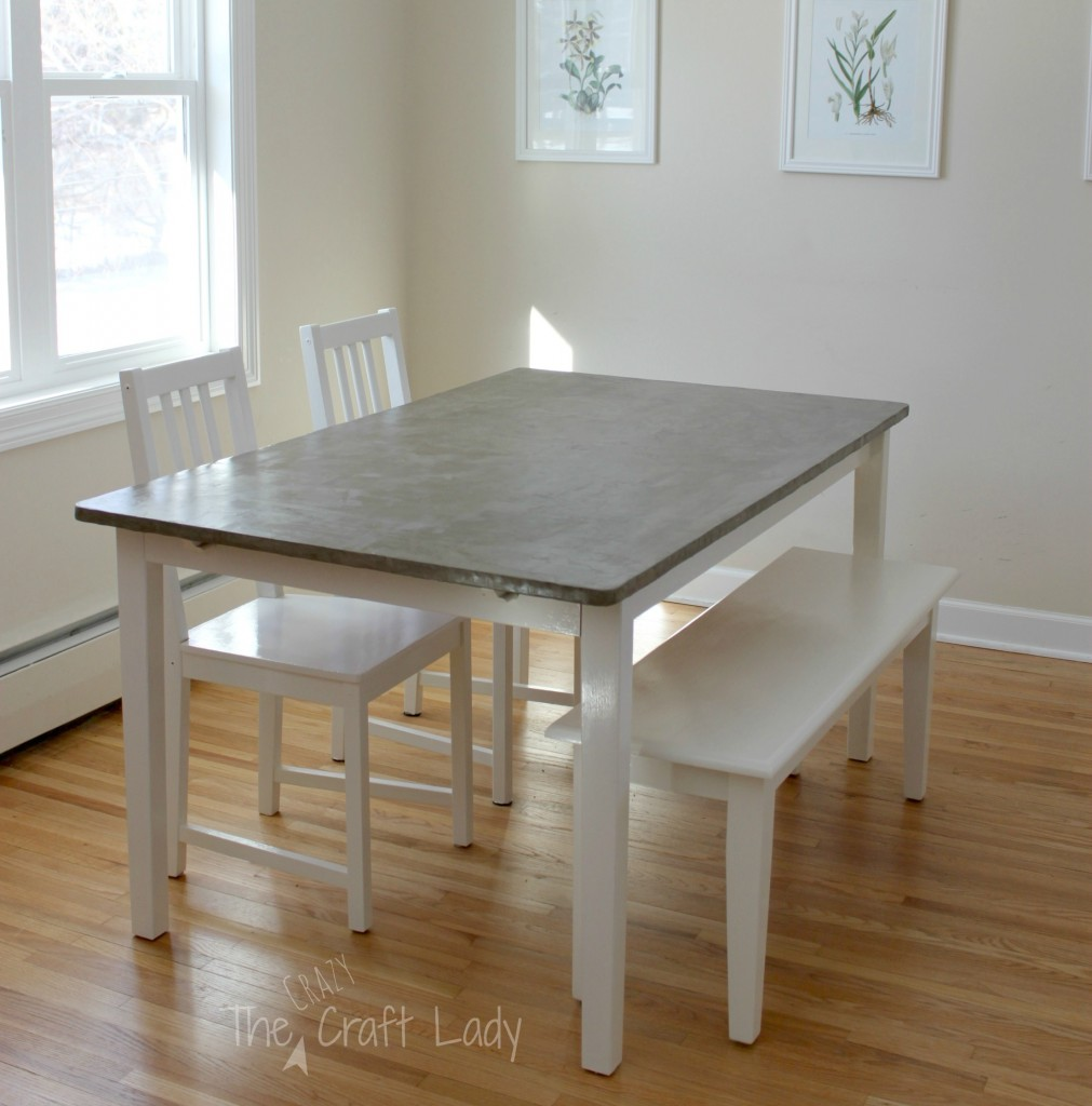 diy concrete table top 2 years later granite top kitchen table DIY Concrete Dining Table Top using Henry FeatherFinish full tutorial from The Crazy Craft Lady