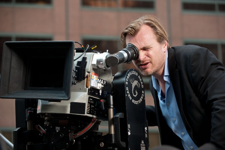"Director CHRISTOPHER NOLAN sets up a shot for Warner Bros. Pictures' and Legendary Pictures' action thriller ""THE DARK KNIGHT RISES,"" a Warner Bros. Pictures release. TM & © DC Comics."