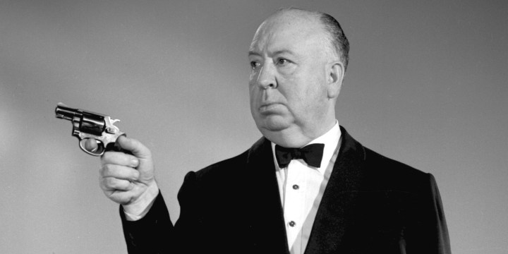 Promotional portrait of British-born American film and television director Alfred Hitchcock (1899 - 1980), dressed in a tuxedo, as he aims a revolver for his anthology program 'The Alfred Hitchcock Hour,' December 12, 1962. (Photo by CBS Photo Archive/Getty Images)