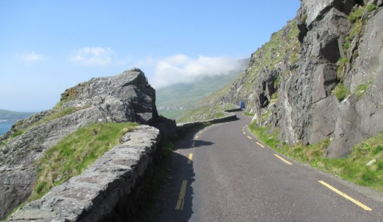The road cuts through the cliffside