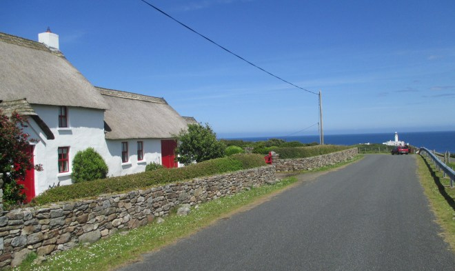 Approaching Fanad Lighthouse going past a thatched cottage