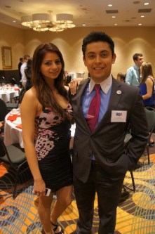 UH-Downtown SGA Senator Lucero Deleon, in a Bebe dress, and UH-Downtown SGA President Ivan Sanchez, in an Express suit, visited their sister school's SGA inauguration. Natalie Harms/The Daily Cougar