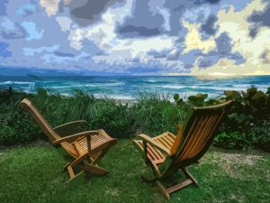 a relaxing spot by the sea with two deck chairs