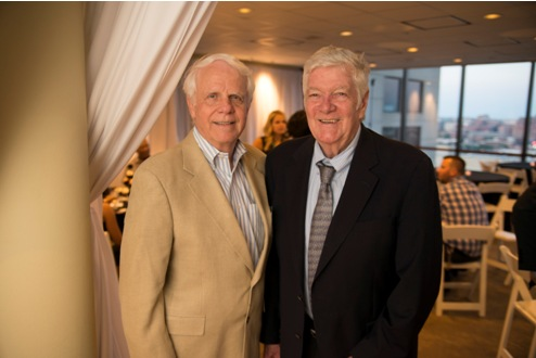 From left, John Hergenroeder, of the Maryland real estate division, poses with J. Joseph Curran, Jr., former attorney general at the Kornblatt Company's recent 50th anniversary celebration.