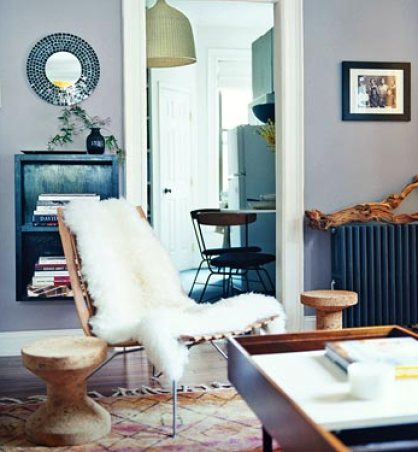 sheepskin throw on chair via apartmenttherapy Highlights from A Neighborhood Home Tour