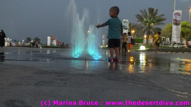 young man enjoying the walk through fountains