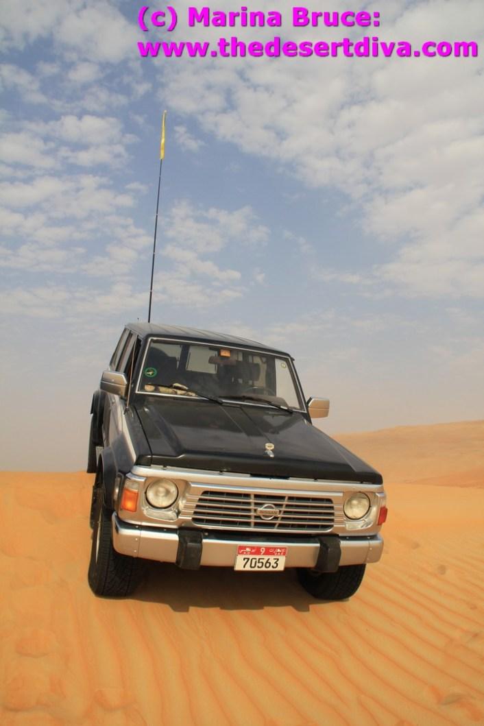 couldn't resist - orange sand, blue sky, black car