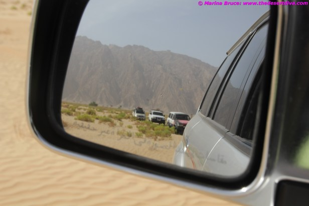 The convoy with Jebel Hafeet in the background
