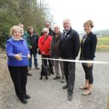 Cllr Joy Cann cuts the ribbon for recently launched Yeo Valley Woodland footpath, of which Coastal Recycling contributed £11,000.