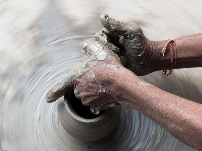 The potters hands. Jodhpur, Rajasthan, India © George Neil
